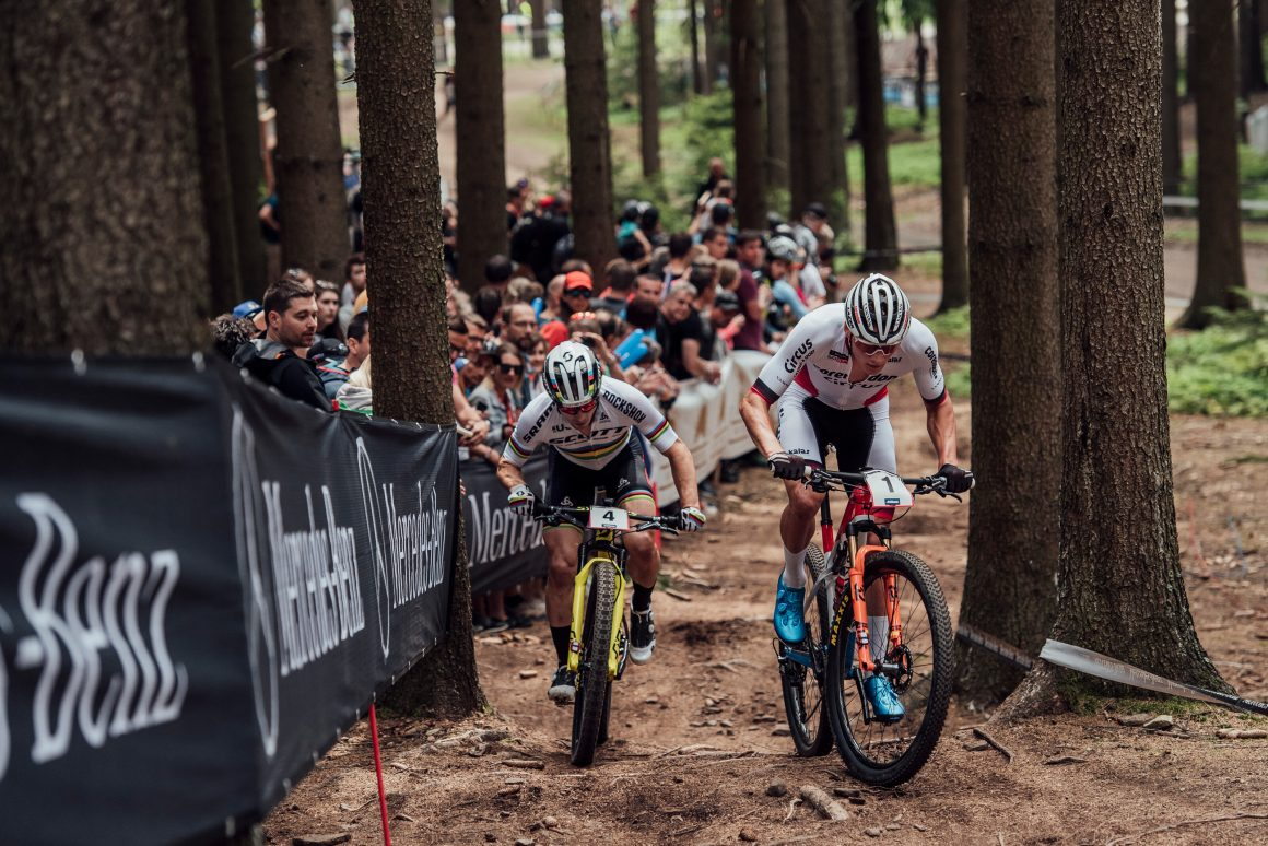 31c04d03074 The Dutchman tracked the six-time World Cup champion for the first half,  then used an uphill surge two laps from the end to create a winning gap. Van  der ...