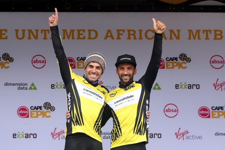 Overall race leaders Henrique Avancini & Manuel Fumic of Cannondale Factory Racing celebrate on the podium during stage 3 of the 2019 Absa Cape Epic Mountain Bike stage race held from Oak Valley Estate in Elgin, South Africa on the 20th March 2019.  Photo by Shaun Roy/Cape Epic  P