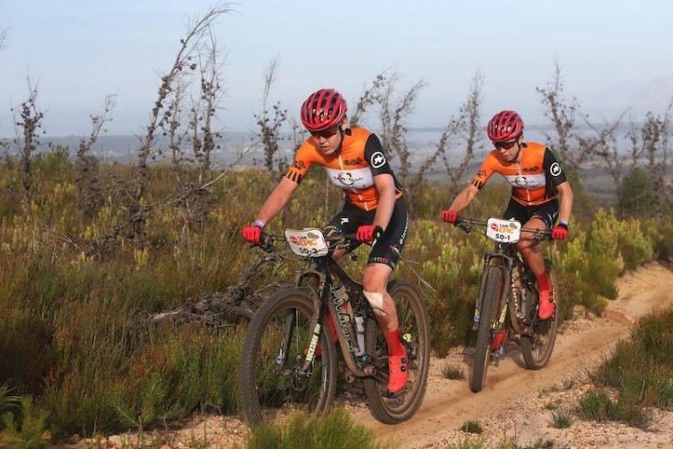 Anna van der Breggen and Annika Langvad of Investec-Songo-Specialized up a climb during stage 2 of the 2019 Absa Cape Epic Mountain Bike stage race from Hermanus High School in Hermanus to Oak Valley Estate in Elgin, South Africa on the 19th March 2019  Photo by Shaun Roy/Cape Epic