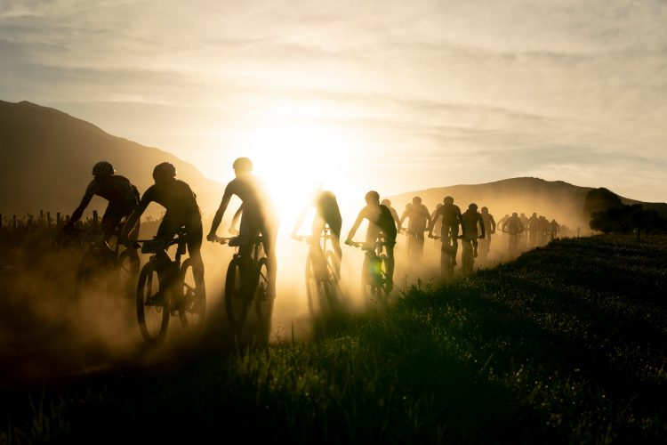Riders silhouetted against the rising sun during stage 2 of the 2019 Absa Cape Epic Mountain Bike stage race from Hermanus High School in Hermanus to Oak Valley Estate in Elgin, South Africa on the 19th March 2019  Photo by Nick Muzik/Cape Epic