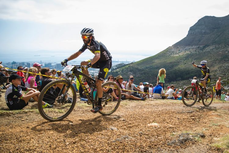 Rene Haselbacher and Sabine Sommer celebrates reaching dead man's tree during the Prologue of the 2015 Absa Cape Epic Mountain Bike stage race held at the University of Cape Town in Cape Town, South Africa on the 15 March 2015  . Photo by Ewald Sadie/Cape Epic/SPORTZPICS