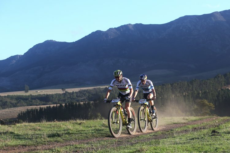 Nino Schurter and Lars Forster of Scott-SRAM MTB-Racing during stage 4 of the 2019 Absa Cape Epic Mountain Bike stage race from Oak Valley Estate in Elgin, South Africa on the 21st March 2019.  Photo by Shaun Roy/Cape Epic