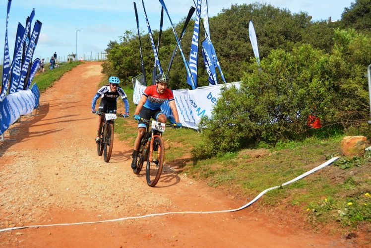 Marco Joubert beats Jason Meaton to the line to win the men's 70km Bestmed-Makro mountain-bike race at the Hopewell Conservation Estate just outside Port Elizabeth today. Picture: Full Stop Communications